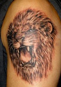 tatuaż - motyw paszczy lwa